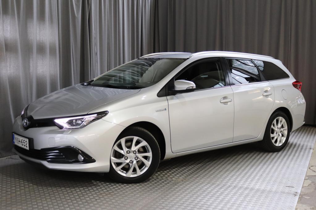 Toyota Auris Touring Sports 1, 8 Hybrid Active Edition,  MERKKIHUOLLETTU!